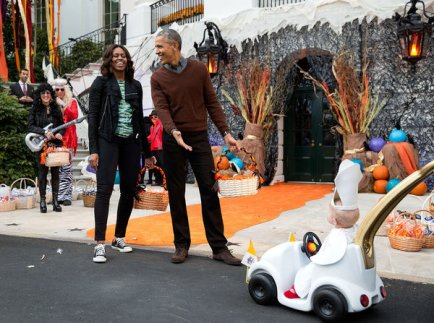 """Oct. 30, 2015 """"The President and First Lady react to a child in a pope costume and mini popemobile as they welcomed children during a Halloween event on the South Lawn of the White House."""" (Official White House Photo by Pete Souza) This official White House photograph is being made available only for publication by news organizations and/or for personal use printing by the subject(s) of the photograph. The photograph may not be manipulated in any way and may not be used in commercial or political materials, advertisements, emails, products, promotions that in any way suggests approval or endorsement of the President, the First Family, or the White House."""