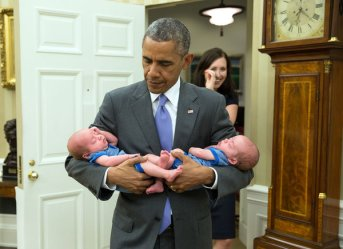 """June 17, 2015 """"The President carries the twin boys of Katie Beirne Fallon, Director of Legislative Affairs, into the Oval Office just a few months after they were born."""" (Official White House Photo by Pete Souza) This official White House photograph is being made available only for publication by news organizations and/or for personal use printing by the subject(s) of the photograph. The photograph may not be manipulated in any way and may not be used in commercial or political materials, advertisements, emails, products, promotions that in any way suggests approval or endorsement of the President, the First Family, or the White House."""