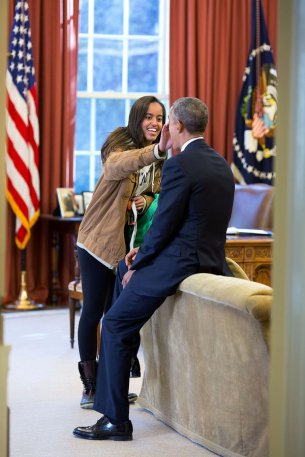 """Feb. 23, 2015 """"The President's daughter Malia stopped by the Oval Office one afternoon to see her dad and, while they were talking, she wiped something from his face."""" (Official White House Photo by Pete Souza) This official White House photograph is being made available only for publication by news organizations and/or for personal use printing by the subject(s) of the photograph. The photograph may not be manipulated in any way and may not be used in commercial or political materials, advertisements, emails, products, promotions that in any way suggests approval or endorsement of the President, the First Family, or the White House."""